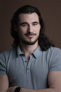 Image is a headshot of Asher Gelman